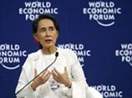 aung san suu kyi defends the jail sentence of two journalists