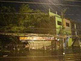 'super-typhoon' with winds of more than 175 miles per hour rips roofs of houses in the philippines