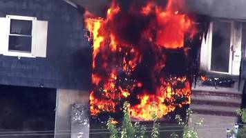 suspected gas explosions set homes ablaze in massachusetts