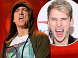 eminem steps up feud with machine gun kelly and drops new diss song about rival rapper