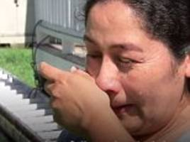 immigrant mother in tears over fears that ice will arrest her is she goes to hurricane shelter