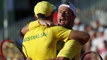 Hewitt picks himself and Australia beat Austria in Davis Cup doubles
