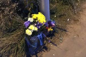 flowers left at the scene of serious bike crash involving 16-year-old boy