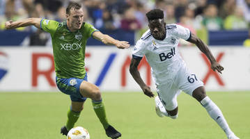 mls: sounders win ninth straight, beating whitecaps 2-1