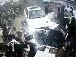 Shocking moment car mow into diners at Starbucks in Turkey