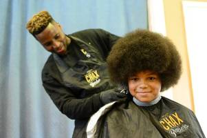 jamaul, 10, braves the shave and says goodbye to afro he's been growing for two years