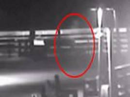 Is this the Gray Man ghost? Figure captured walking on North Carolina pier during Hurricane Florence