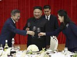 North Korean's Kim Jong-un and South Korea's Moon toast to peace talks during lavish banquet