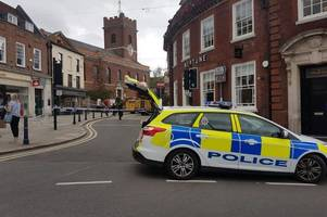 Woman 'helped to safety' from roof during Guildford High Street closure