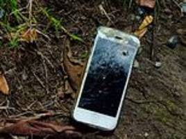 cop is saved from being shot in the groin when bullet lodges in his iphone