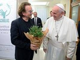 pope francis and u2 frontman bono share an embrace in vatican city
