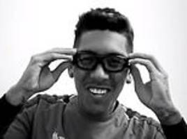 Roberto Firmino in protective glasses after scoring winner against PSG