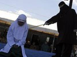 indonesian woman is caned in front of cheering onlookers for having sex outside of marriage