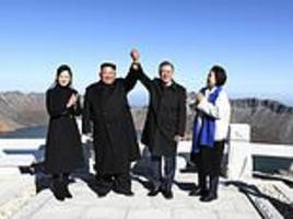 kim, moon join hands on peak of sacred north korean...