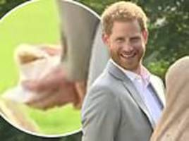 prince harry caught sneaking samosas as he supports meghan markle