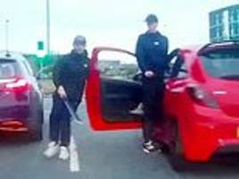 terrifying moment two brothers attack a taxi with a machete during road rage row
