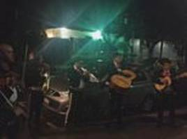 mariachi singer hired to serenade man's girlfriend realises the lady is his wife