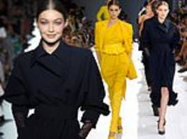 gigi hadid and kaia gerber storm the max mara runway during mfw