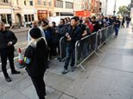the wait is over! hundreds of apple fans queue outside to get their hands on the new iphone xs