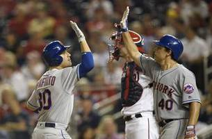 Lobaton's sacrifice fly lifts Mets past Nationals in 12