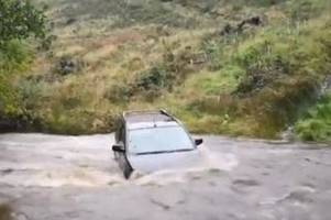 car seen floating down the river as storm bronagh hits wales