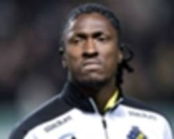 former manchester city midfielder dickson etuhu charged with bribery in sweden