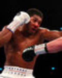 joshua vs povetkin: dramatic pics of aj covered in blood after first round nose injury