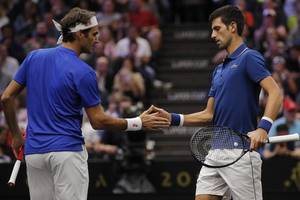 roger federer and novak djokovic beaten in doubles but team europe take overnight laver cup lead
