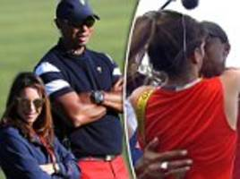 tiger woods' girlfriend erica herman celebrates with the legend after his first win in five years