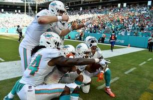Up their sleeve: Dolphins breaking out the trick plays en route to surprising 3-0 start