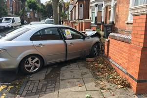 Man arrested after car smashes into wall