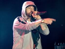 eminem's feud with rapper machine gun kelly is dominating youtube