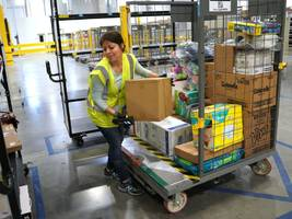 some amazon warehouse workers are getting raises after repeated high-profile attacks on the retailer's pay (amzn)