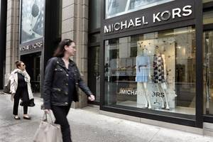 Michael Kors makes high-end fashion statement with $2.2 bln Versace buy