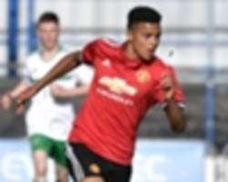 greenwood signs first professional deal at manchester united