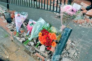 flowers and tributes left at scene of a50 crash which claimed woman's life