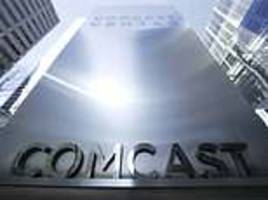 comcast raises £21bn to help finance its blockbuster takeover of british broadcaster sky