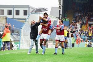 this was the aston villa umbrella fan that sparked dalian atkinson's jolly with a brolly