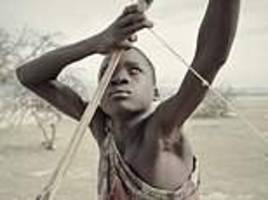 battle of the hunter gatherers: tanzanian tribe who must fight to preserve their way of life