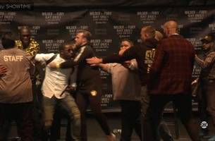 tempers flare as deontay wilder, tyson fury get into shoving match