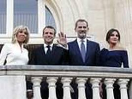 president macron and his wife join spanish king and queen at paris art exhibition