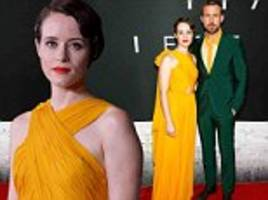 claire foy matches in yellow with co-star ryan gosling at first man premiere