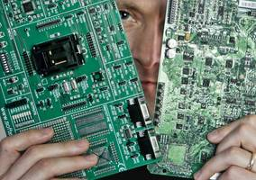 could spies actually insert malicious chips into computer circuit boards? a manufacturing expert says it's possible (aapl, amzn, smci)