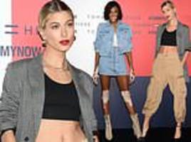 hailey baldwin flashes her abs in revealing crop top at tommy hilfiger fashion launch