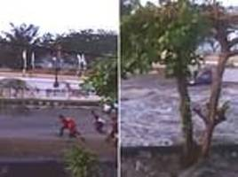 terrifying new footage of indonesian tsunami shows how streets transformed into raging rivers