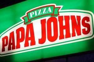 a new papa john's store is opening - right next to a domino's