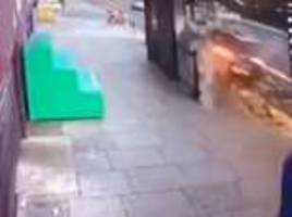 terrifying cctv footage shows speeding car crashing into london bus stop