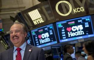 CVS and Aetna are gaining ground after their $69 billion merger gets the green light (CVS, AET)