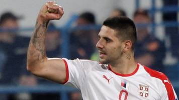mitrovic scores as serbia beat montenegro in historic meeting