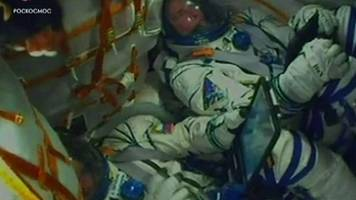 soyuz crew back to earth after malfunction